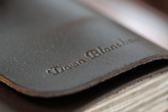 ...My name engraved in the rich brown leather...